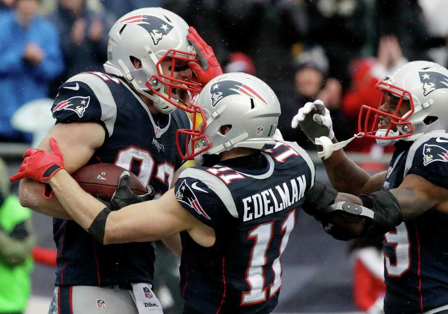 New England Patriots tight end Matt Lengel, left, celebrates his touchdown catch with Julian Edelman, center, and Malcolm Mitchell during the first half of an NFL football game against the New York Jets, Saturday, Dec. 24, 2016, in Foxborough, Mass. (AP Photo/Charles Krupa) ORG XMIT: FBO125 Photo: Charles Krupa / Copyright 2016 The Associated Press. All rights reserved.