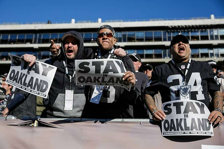 Go, team — but then again, please stay, team: Raiders fans Sofo Kyriakopedi, Don Caldwell and Vikesh Balgobind deliver the message at the team's home finale against the Colts last month. Photo: Gabrielle Lurie, The Chronicle