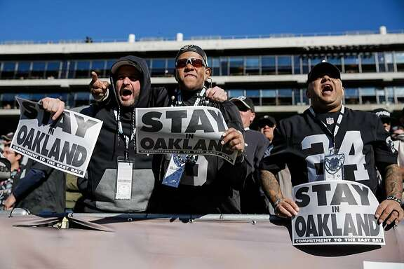 Raiders fans Sofo Kyriakopedi,  Don Caldwell, Vikesh Balgobind cheer during a game between the Oakland Raiders and the Indiana Colts, in Oakland, Calif., on Saturday, Dec. 24, 2016.