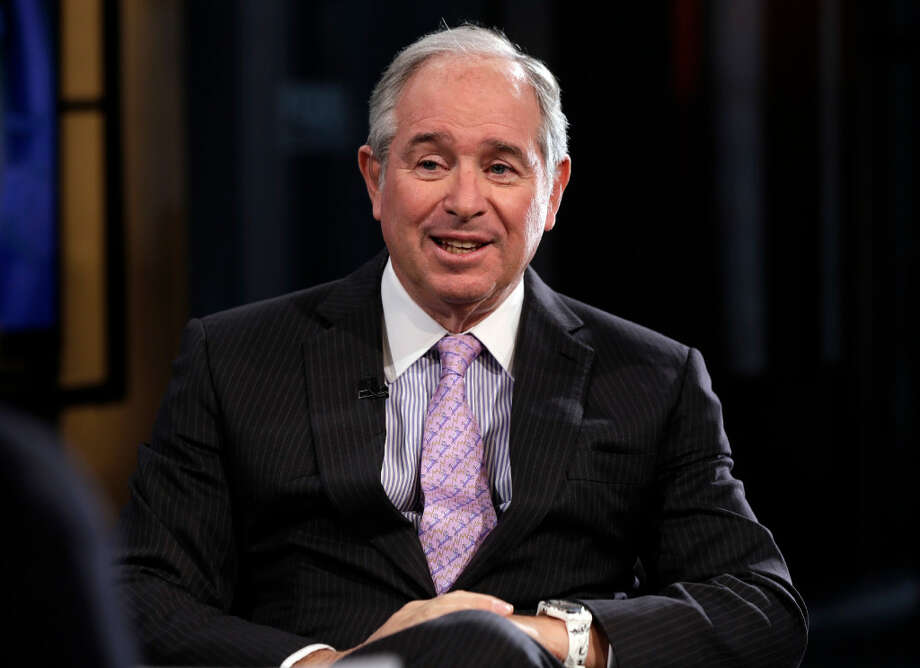 "Blackstone Group CEO Stephen Schwarzman is interviewed in 2014 by Maria Bartiromo during her ""Opening Bell with Maria Bartiromo"" program, on the Fox Business Network, in New York. President-elect Donald Trump on Dec. 2 announced the formation of an advisory group, led by Schwarzman, of more than a dozen CEOs and business leaders who will offer input on how to create jobs and speed economic growth."