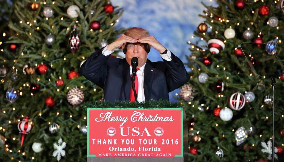 President-elect Donald Trump acknowledges the size of the crowd, in front of a backdrop of Christmas trees, at a rally in Orlando, Fla., Friday night, Dec. 16, 2016. (Joe Burbank/Orlando Sentinel via AP) ORG XMIT: FLORL506 Photo: Joe Burbank / Orlando Sentinel 2016