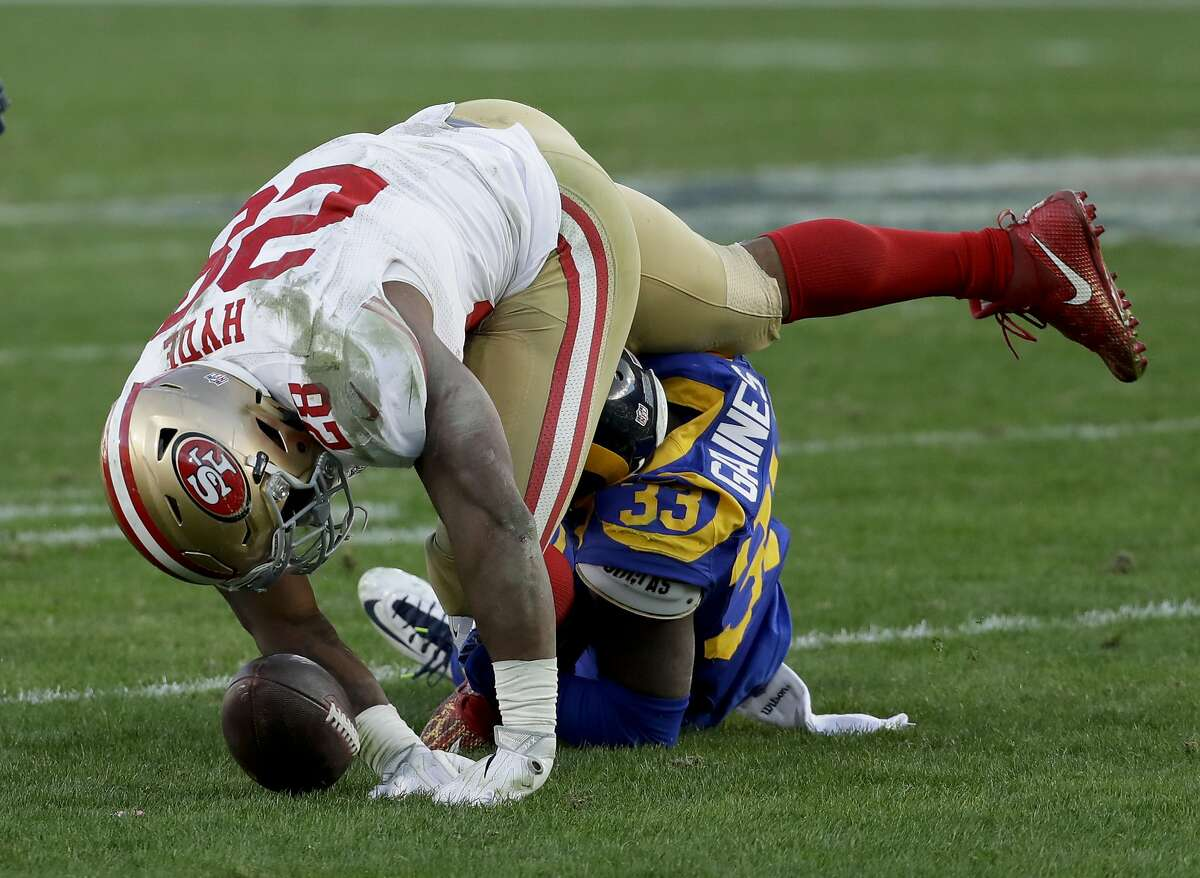 Los Angeles Rams cornerback E.J. Gaines hits San Francisco 49ers running back Carlos Hyde forcing a fumble during the second half of an NFL football game Saturday, Dec. 24, 2016, in Los Angeles. (AP Photo/Rick Scuteri)