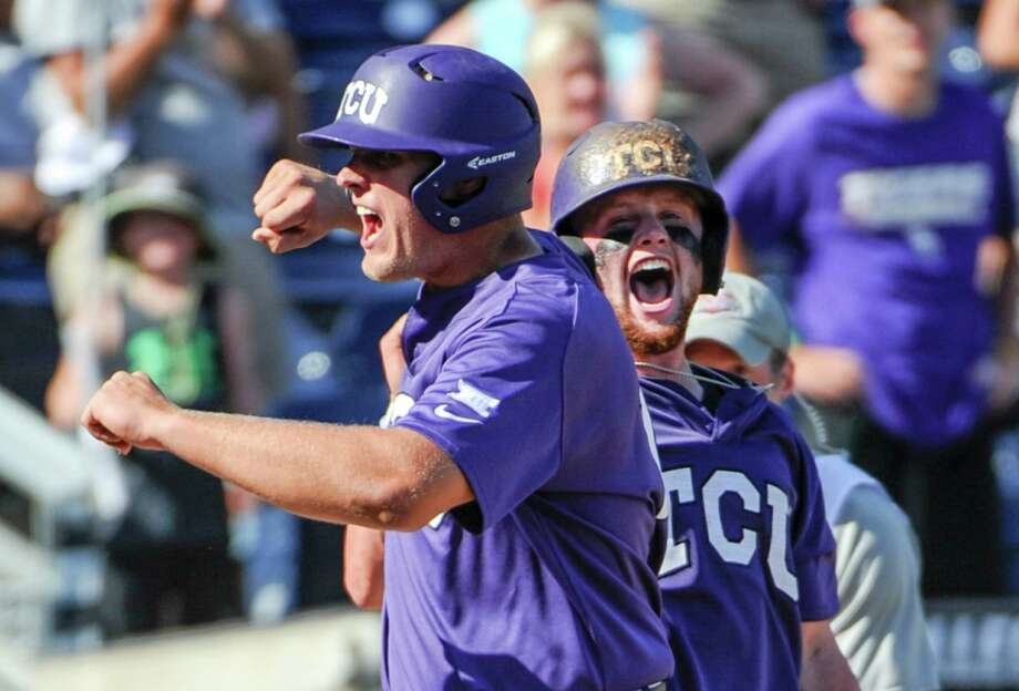 TCU's Luken Baker, left, celebrates at the dugout after hitting a three-run home run during the ninth inning of an NCAA men's College World Series baseball game against Texas Tech in Omaha, Neb., Sunday, June 19, 2016. TCU won 5-3. (AP Photo/Mike Theiler) Photo: Mike Theiler, FRE / FR170180 AP