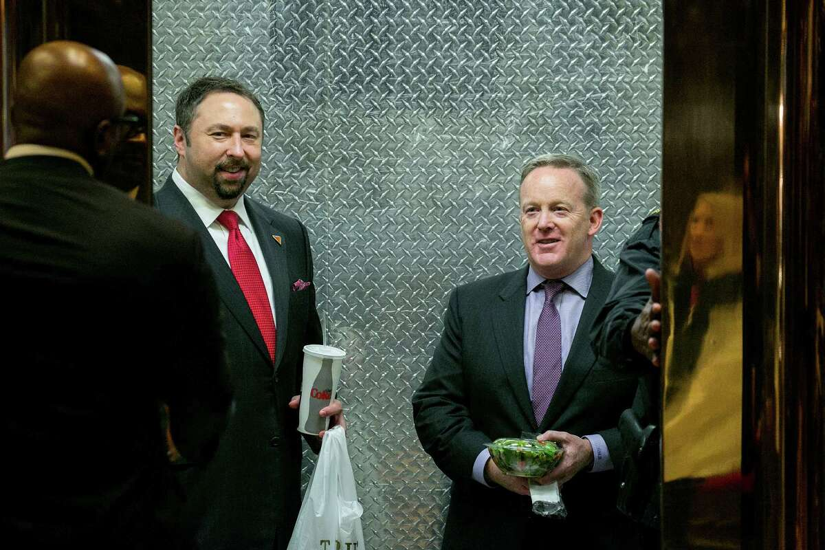 FILE Â?- Jason Miller, left, a Trump campaign spokesman, and Sean Spicer, the Republican National Committee's chief strategist and communication director, take an elevator at Trump Tower in New York, Nov. 29, 2016. Spicer was announced as Donald TrumpÂ?'s press secretary on Dec. 22, while Miller will become communications director. (Sam Hodgson/The New York Times)