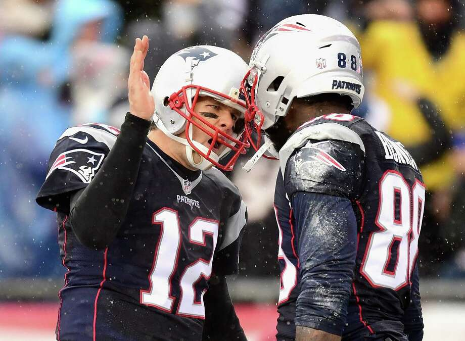 FOXBORO, MA - DECEMBER 24: Martellus Bennett #88 of the New England Patriots reacts with Tom Brady after catching a touchdown pass during the first quarter of a game against the New York Jets at Gillette Stadium on December 24, 2016 in Foxboro, Massachusetts.  (Photo by Billie Weiss/Getty Images) Photo: Billie Weiss, Stringer / 2016 Getty Images