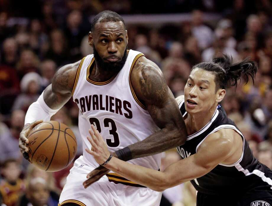 Cleveland Cavaliers' LeBron James, left, drives to the basket against Brooklyn Nets' Jeremy Lin in the second half of an NBA basketball game, Friday, Dec. 23, 2016, in Cleveland. (AP Photo/Tony Dejak) Photo: Tony Dejak, STF / AP 2016