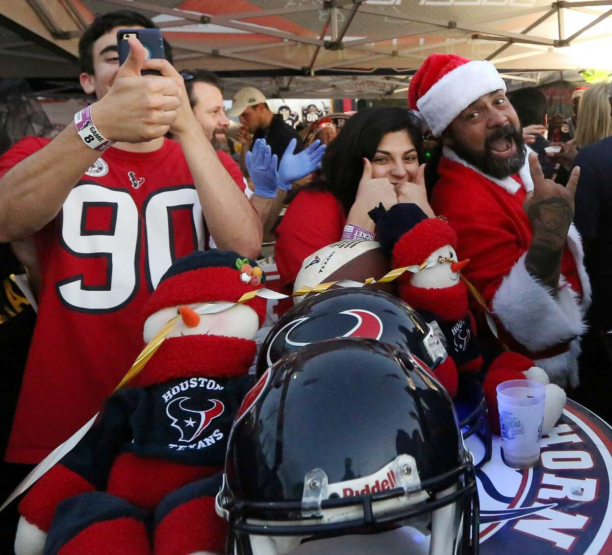 People pose for a photo before an NFL game between the Houston Texans and the Cincinnati Bengals, at NRG Stadium, Saturday, Dec. 24, 2016, in Houston. ( Jon Shapley / Houston Chronicle )