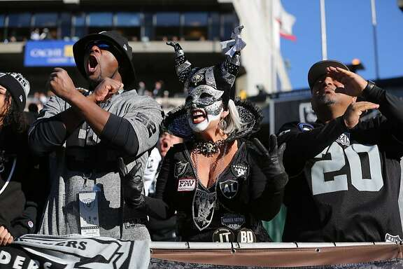 Raiders fans Kesa Hardine, Pati McGaffigan and Chuck Hardine cheer during a game between the Oakland Raiders and the Indiana Colts, in Oakland, Calif., on Saturday, Dec. 24, 2016.