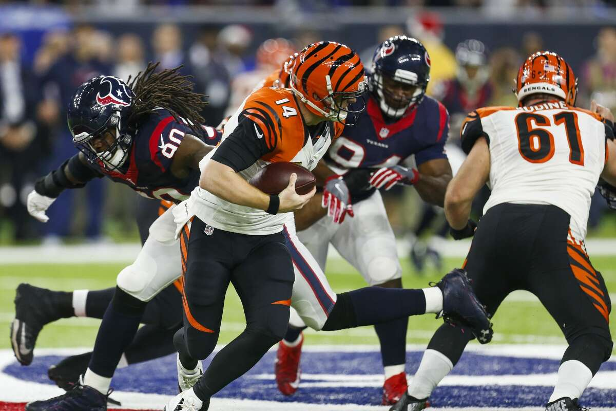 Houston Texans defensive end Jadeveon Clowney (90) misses a sack on Cincinnati Bengals quarterback Andy Dalton (14) during the second quarter of an NFL football game at NRG Stadium on Saturday, Dec. 24, 2016, in Houston. ( Brett Coomer / Houston Chronicle )