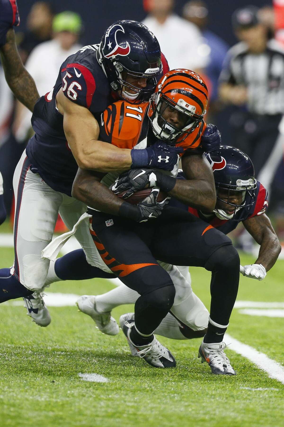 Houston Texans inside linebacker Brian Cushing (56) and cornerback Johnathan Joseph (24) tackle Cincinnati Bengals wide receiver Brandon LaFell (11) during the second quarter of an NFL football game at NRG Stadium on Saturday, Dec. 24, 2016, in Houston. ( Brett Coomer / Houston Chronicle )