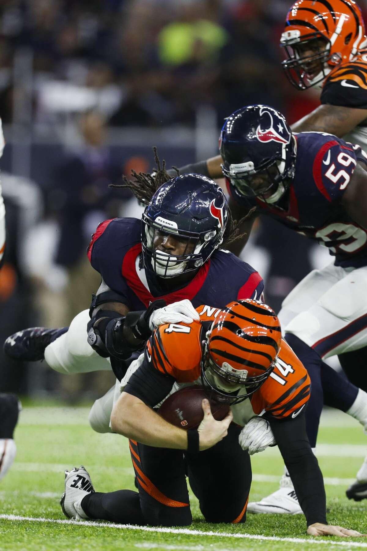 Houston Texans defensive end Jadeveon Clowney (90) sacks Cincinnati Bengals quarterback Andy Dalton (14) during the second quarter of an NFL football game at NRG Stadium, Saturday,Dec. 24, 2016 in Houston. ( Karen Warren / Houston Chronicle )