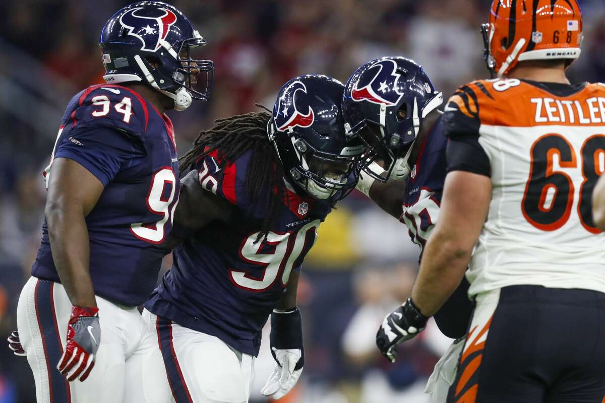 Houston Texans defensive end Jadeveon Clowney (90) is congratulated after sacking Cincinnati Bengals quarterback Andy Dalton (14) during the second quarter of an NFL football game at NRG Stadium, Saturday,Dec. 24, 2016 in Houston. ( Karen Warren / Houston Chronicle )