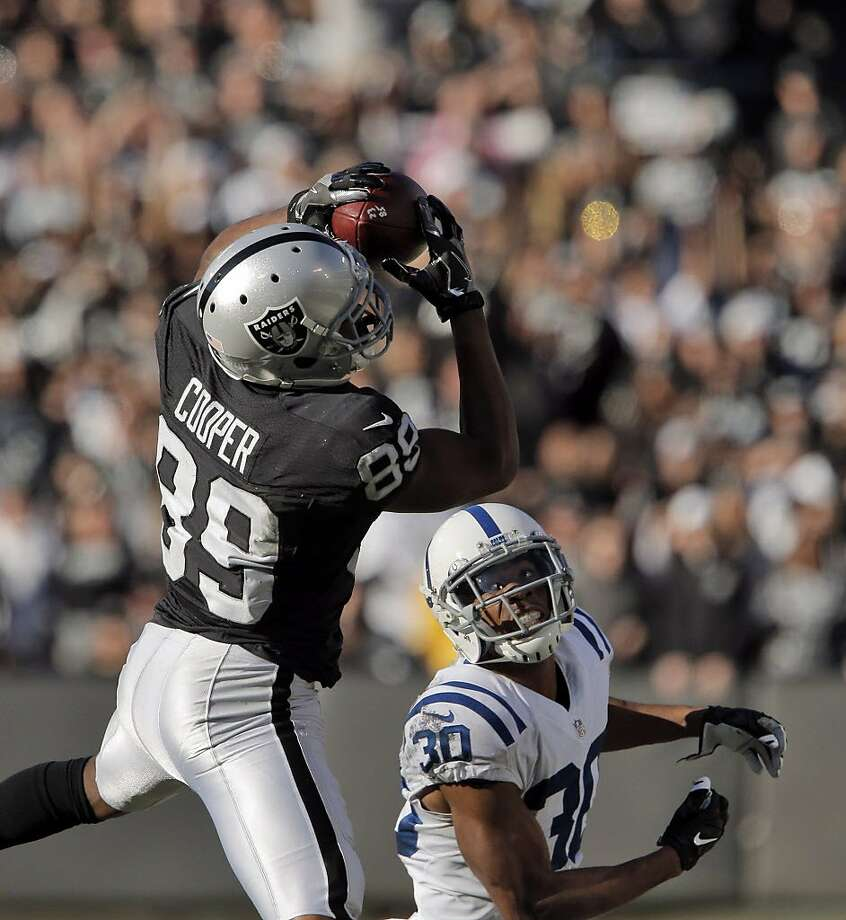 Amari Cooper (89) pulls in a catch over Rashaan Melvin (30) in the second quarter as the Oakland Raiders played the Indianapolis Colts at the Oakland Coliseum in Oakland, Calif., on Saturday, December 24, 2016. The Raiders won the game 33-25, but lost quarterback Derek Carr to injury. Photo: Carlos Avila Gonzalez, The Chronicle