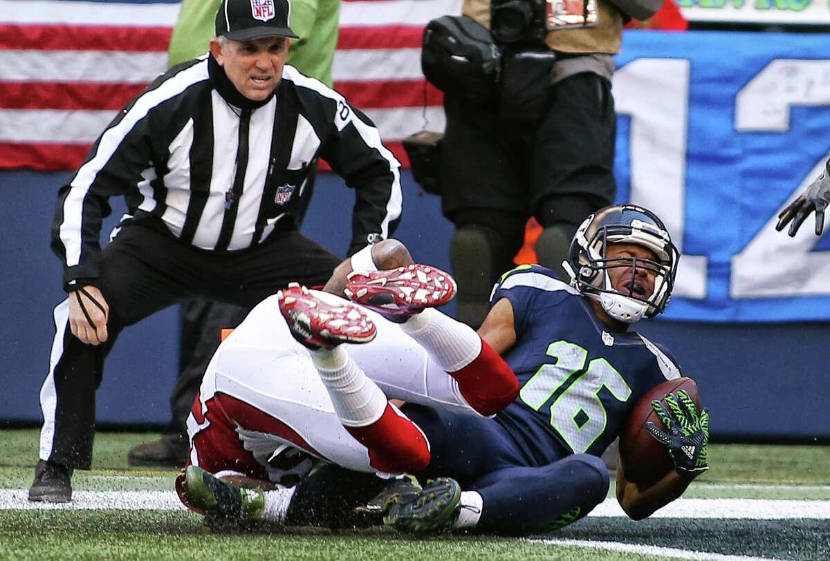 Cardinals cornerback Brandon Williams lands on the leg of Seahawks wide receiver Tyler Lockett, injuring him, during a tackle just short of a touchdown for Lockett. Lockett left the field on a cart. (Genna Martin, seattlepi.com)
