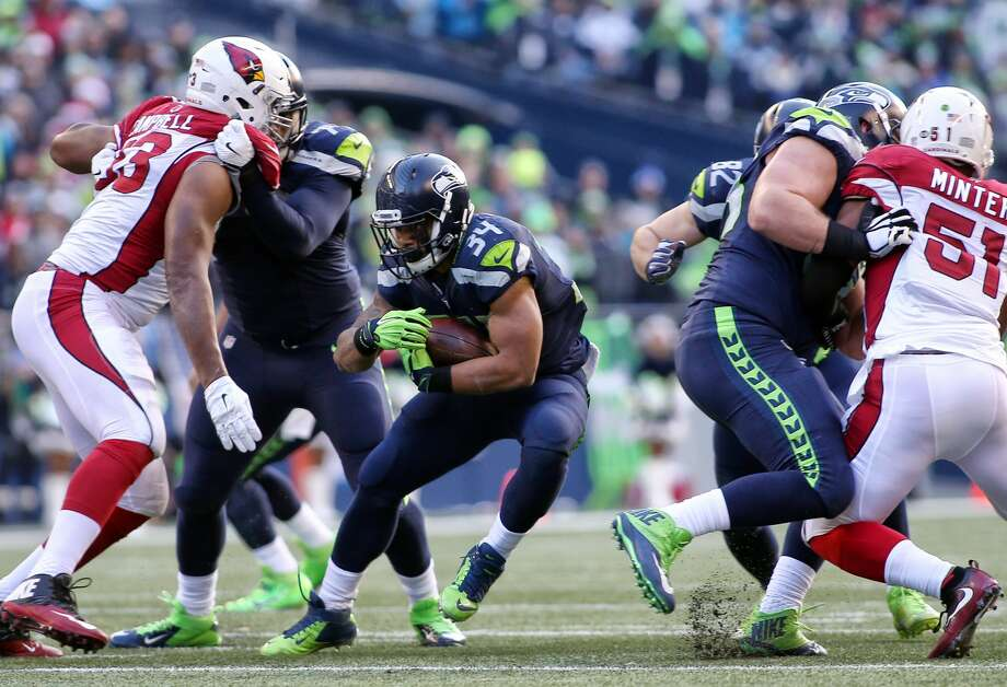 Seahawks running back Thomas Rawls picks up a few yards on a run during the first half of Seattle's game against Arizona, Saturday, Dec. 24, 2016 at CenturyLink Field.   (Genna Martin, seattlepi.com) Photo: GENNA MARTIN/SEATTLEPI.COM, G