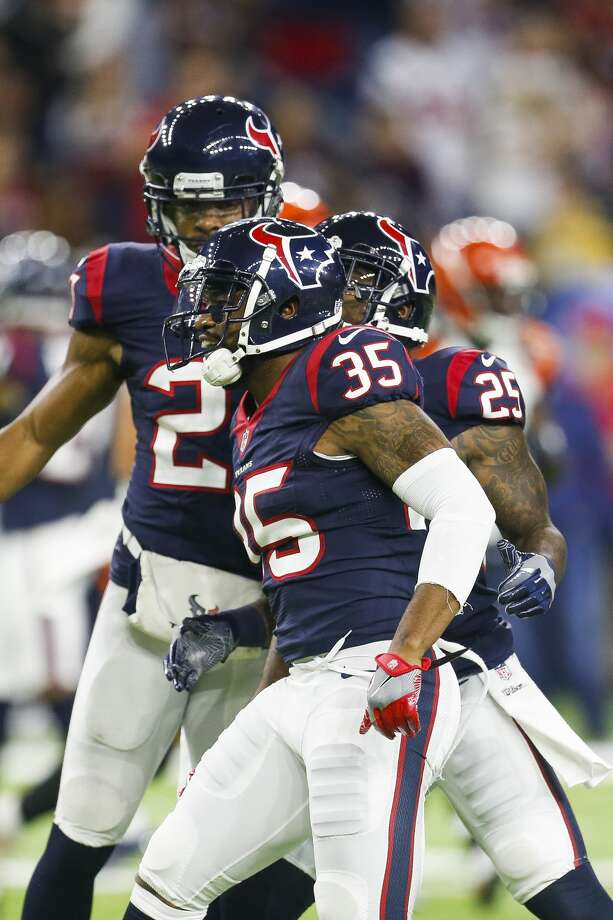 Houston Texans cornerback Kareem Jackson (25) congratulates defensive back Eddie Pleasant (35) on a tackle during the third quarter of an NFL football game at NRG Stadium on Saturday, Dec. 24, 2016, in Houston. ( Brett Coomer / Houston Chronicle ) Photo: Brett Coomer/Houston Chronicle