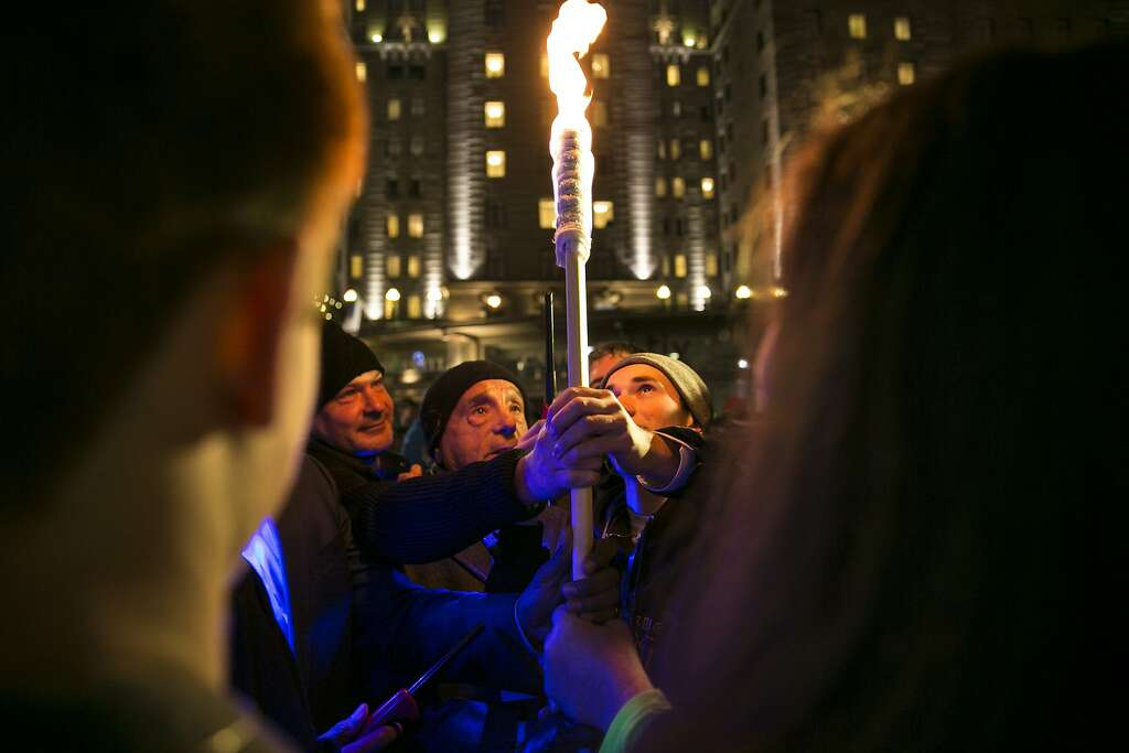 People grab on to the torch as itu0027s being lit in the 42nd-annual candle & Menorah lighting in Union Square - SFGate azcodes.com