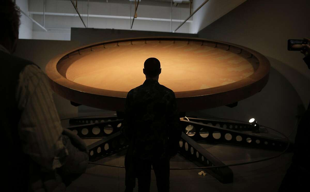 Bart Admonius looks at the movement of Ned Kahn's Negev Wheel at the Contemporary Jewish Museum in San Francisco, Calif., on Sunday, December 25, 2016. The