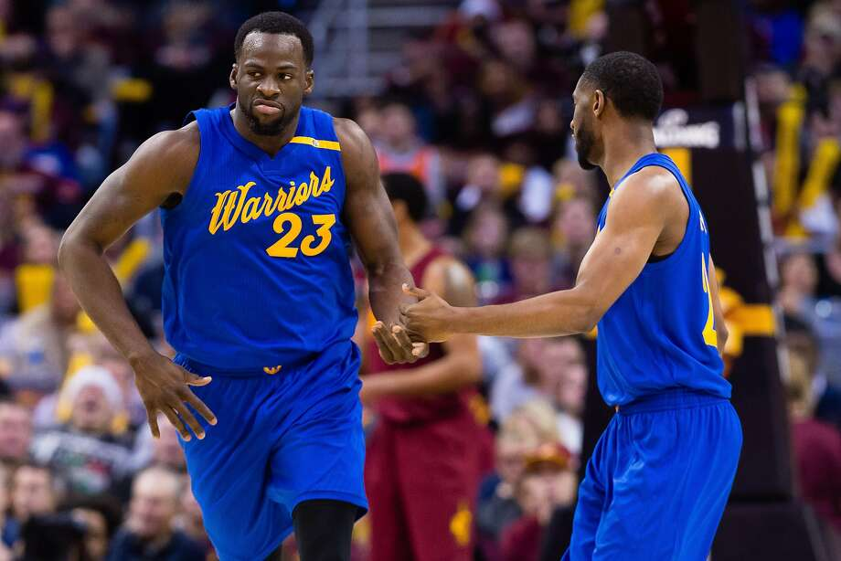 CLEVELAND, OH - DECEMBER 25: Draymond Green #23 celebrates with Ian Clark #21 of the Golden State Warriors during the second half at Quicken Loans Arena on December 25, 2016 in Cleveland, Ohio. The Cavaliers defeated the Warriors 109-108. Photo: Jason Miller, Getty Images