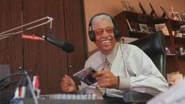 "Gospel radio host Skipper Lee Frazier is moved by a ""kicking record"" as he broadcasts his show over Baytown's KWWJ from a makeshift studio in his funeral home on South Wayside Drive. Frazier began his long Broadcasting career in the late 1950s as a Sunday disc jockey while holding down a full-time job as a mail carrier."