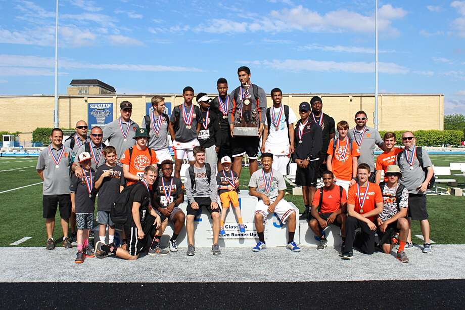The Edwardsville boys' track and field team poses with the second-place trophy at the Class 3A state track meet at Eastern Illinois University in Charleston.