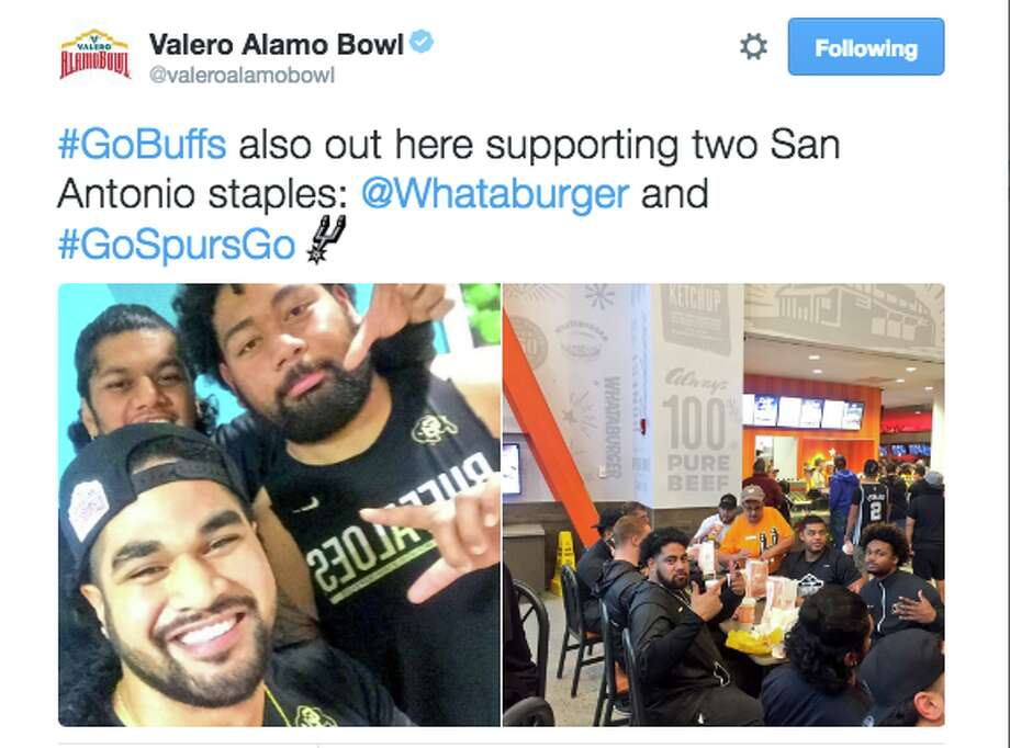 Colorado football players eat Whataburger and watch the Spurs on Christmas Day. Photo: Twitter