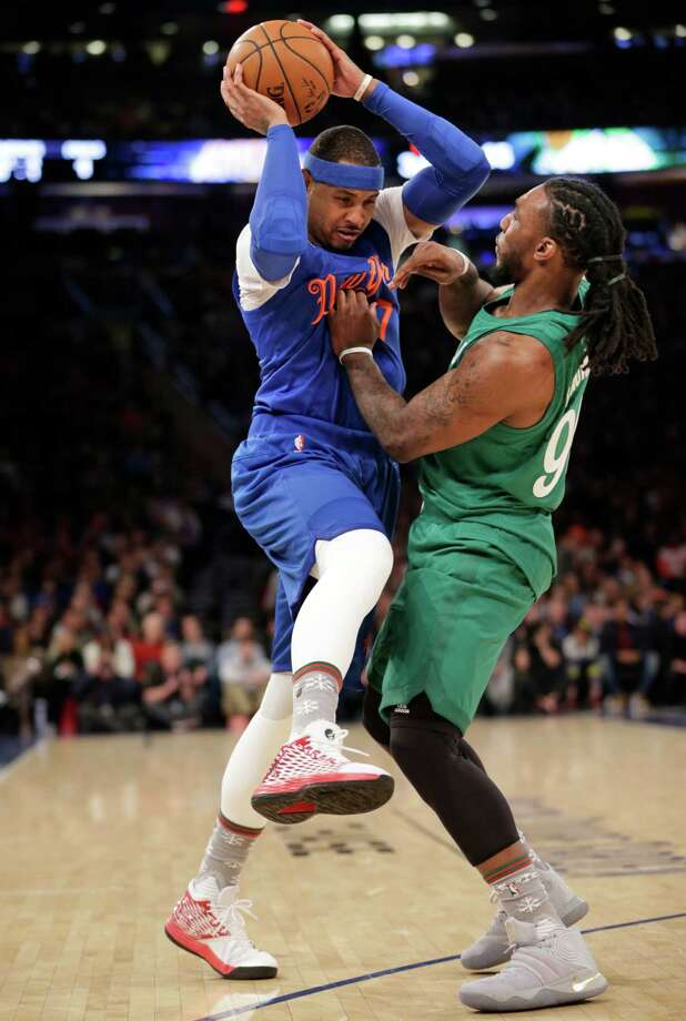 New York Knicks' Carmelo Anthony, left, goes up against Boston Celtics' Jae Crowder during the first half of the NBA basketball game, Sunday, Dec. 25, 2016 in New York. (AP Photo/Seth Wenig) ORG XMIT: NYSW105 Photo: Seth Wenig / Copyright 2016 The Associated Press. All rights reserved.