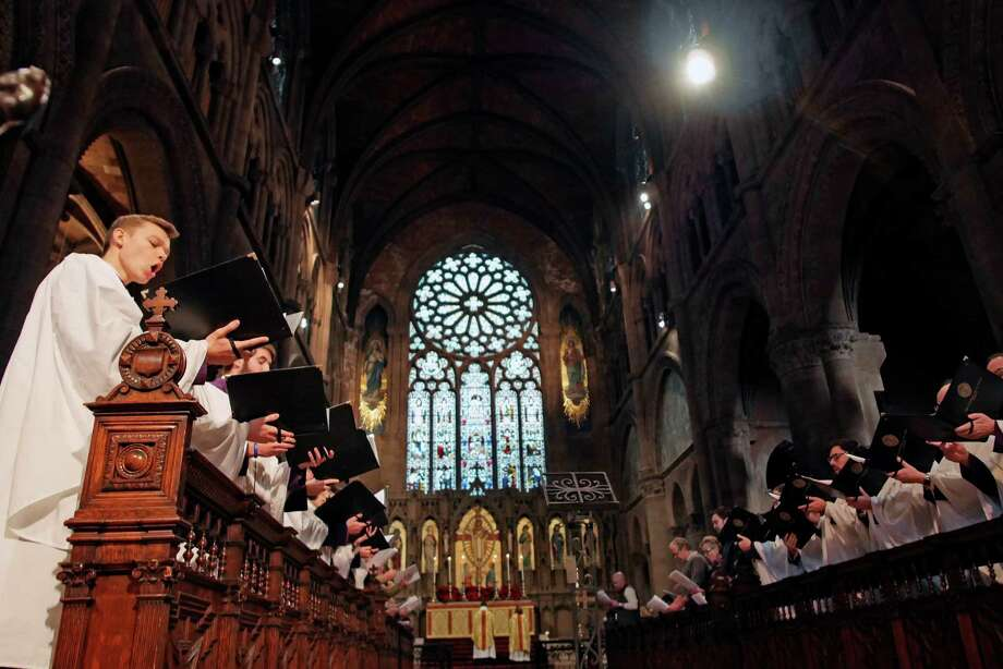Members of the Cathedral Choir of Men and Boys sing during the Christmas day service at The Cathedral of All Saints on Sunday, Dec. 25, 2016, in Albany, N.Y.   (Paul Buckowski / Times Union) Photo: PAUL BUCKOWSKI / 20039203A
