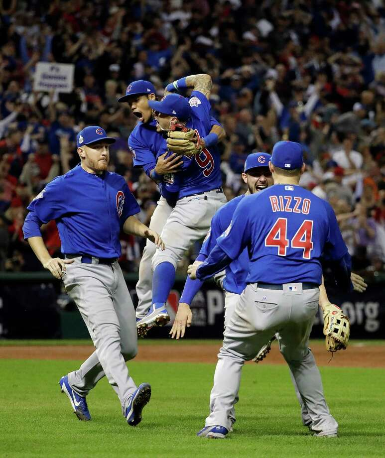 FILE - In this Nov. 3, 2016 file photo, the Chicago Cubs celebrate after Game 7 of the Major League Baseball World Series against the Cleveland Indians in Cleveland. The Cubs won 8-7 in 10 innings to win the series 4-3. (AP Photo/David J. Phillip, File) ORG XMIT: NYCD123 Photo: David J. Phillip / Copyright 2016 The Associated Press. All rights reserved.