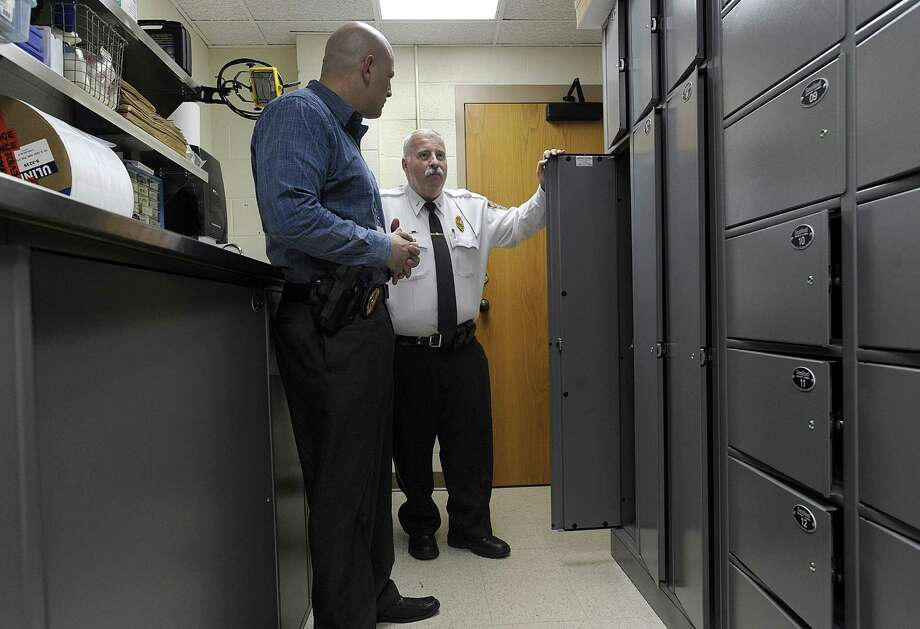 Lt. Jeff Covello, left and Lt. William Scribner talk about the features in the departents evidence room. The investigation truck that the department is hoping to purchase will have a similar layout. The New Milford Police Department is looking to raise money for a new major investigations truck. Photo Thursday, Dec. 22, 2016. Photo: Carol Kaliff / Hearst Connecticut Media / The News-Times