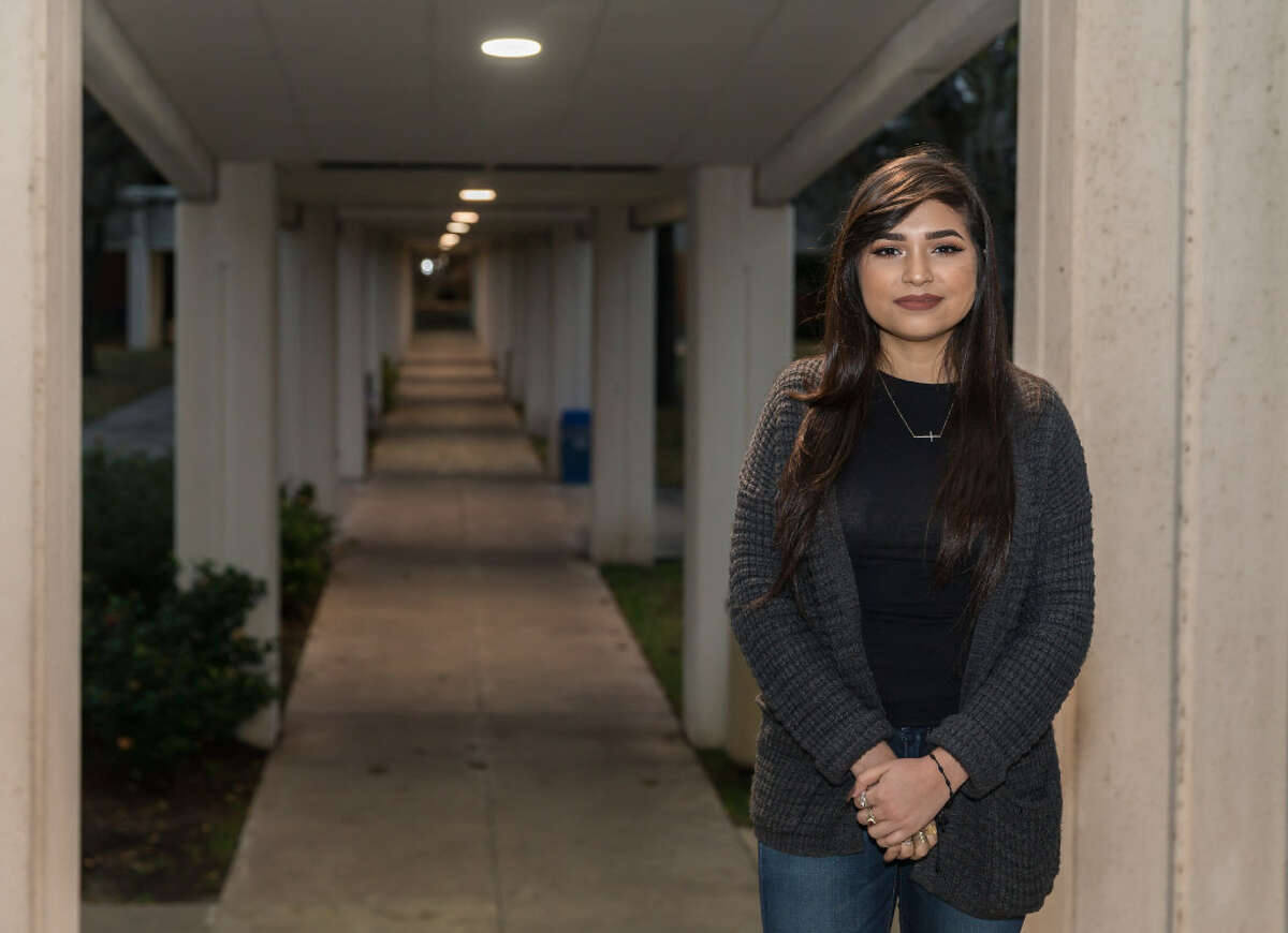 Dania Amezquita, 19, stands near a walkway at San Jacinto College in Pasadena, where she is a student. Amezquita represents the next wave of Hispanic voters who could turn Texas into a battleground state.