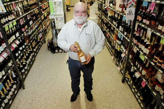 Spec's Bear Dalton picks out his favorite bubblie for the the season: a rose by Jacques Picard on  Tuesday, Dec. 6, 2016, in Houston. ( Elizabeth Conley / Houston Chronicle )