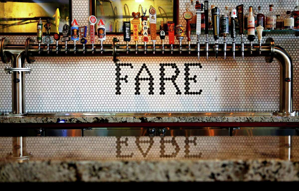 Fancy tile work adorns the wall behind the bar at State Fare Kitchen & Bar in Memorial City.