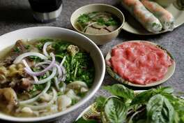 A bowl of pho dac biet with tai and side bowl of bo vien is shown at Pho Saigon, 2808 Milam St., Wednesday, Dec. 21, 2016, in Houston. ( Melissa Phillip / Houston Chronicle )