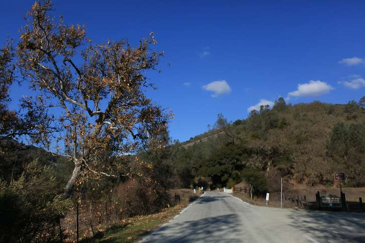 A road winds past the Hunting Hollow entrance at Henry W. Coe State Park on Tuesday, December 13, 2011 in Morgan Hill, Calif.
