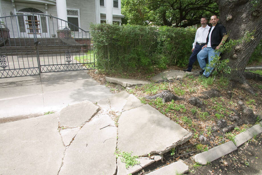 In this 2009 photo, Stephen Longmire, MD, FirstMontroseCommons Director of Communication, left, and Jason Ginsburg show some deteriorated sidewalks andstreetcorners in  Montrose.  Photo: R. Clayton McKee, Freelance / © R. Clayton McKee