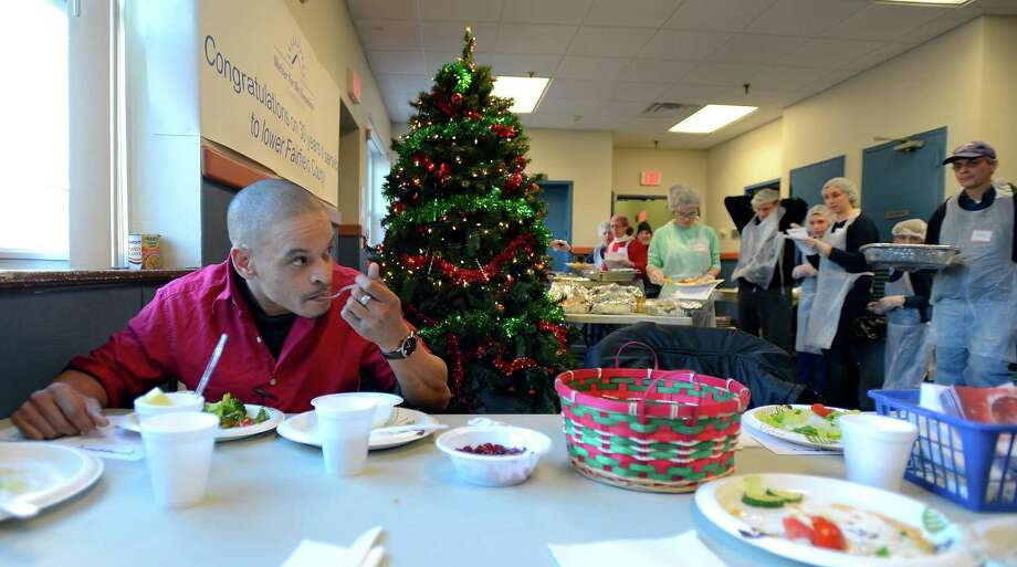 David Dukes, a client of Pacific House, enjoys a holiday meal at the Stamford shelter on Dec.25, 2016. Photo: Matthew Brown, Hearst Connecticut Media / Stamford Advocate
