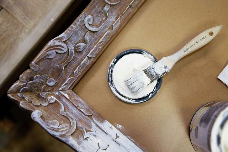 Amitha Verma, who owns Village Antiques, demonstrates how to paint a picture frame with the chalk finish paint for furniture, cabinets and home decor she created Friday, August 12, 2016 in Houston. The paint is available through True Value Hardware stores nationwide as well as on the Home Shopping Network. ( Michael Ciaglo / Houston Chronicle )