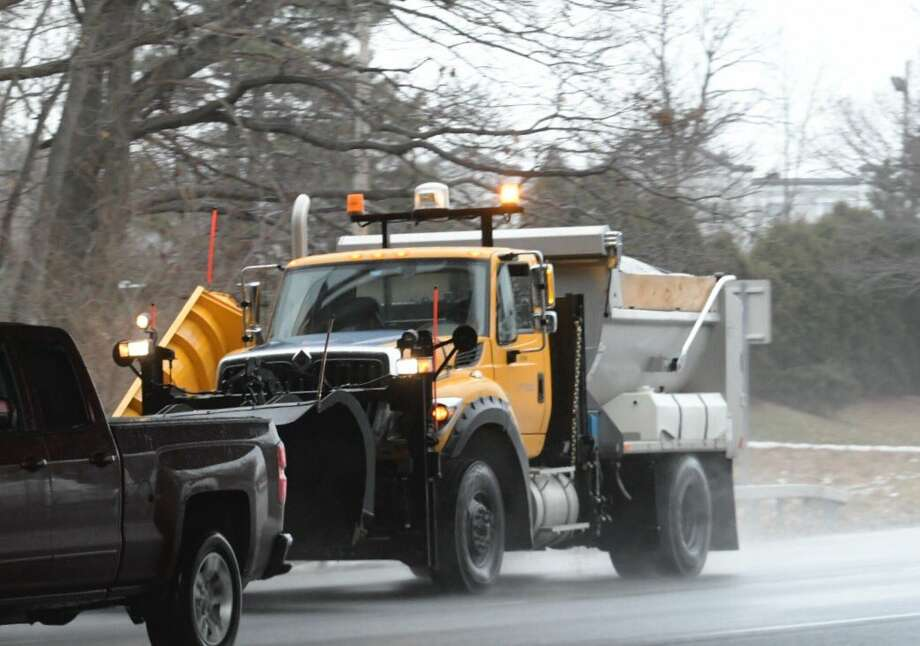 State Department of Transportation sanders are out in Clifton Park, NY, as roads turn icy at midday on Monday, Dec. 26, 2016. (Skip Dickstein/Times Union)