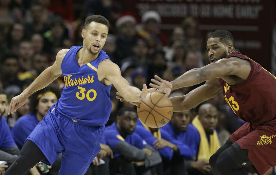 Golden State Warriors' Stephen Curry, left, and Cleveland Cavaliers' Tristan Thompson battle for a loose ball in the first half of an NBA basketball game, Sunday, Dec. 25, 2016, in Cleveland. (AP Photo/Tony Dejak) Photo: Tony Dejak, Associated Press
