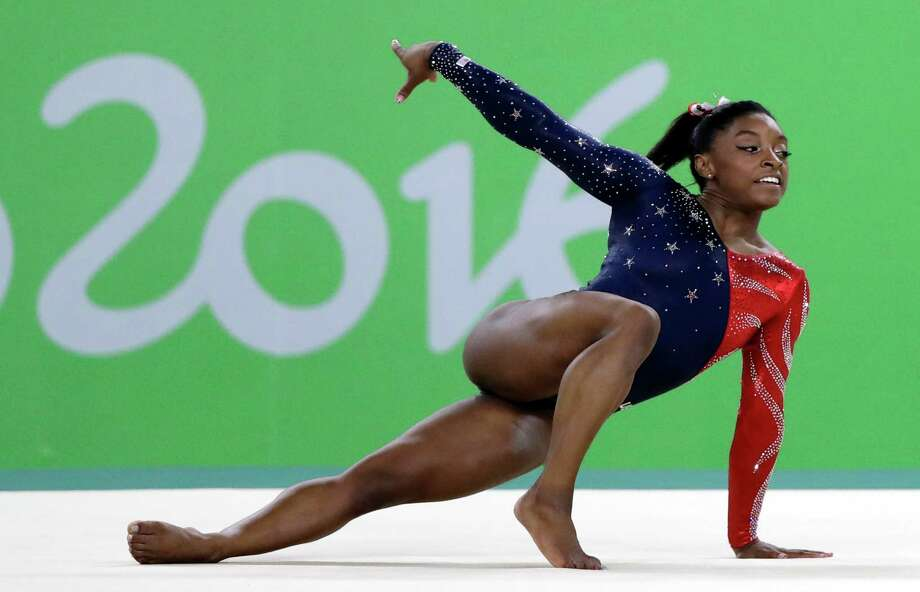 FILE - In this Aug. 7, 2016, file phot,o, United States' Simone Biles performs on the floor during the artistic gymnastics women's qualification at the 2016 Summer Olympics in Rio de Janeiro, Brazil. Briles was selected as the AP Female Athlete of the Year, on Monday, Dec. 26, 2016. (AP Photo/Rebecca Blackwell, File) Photo: Rebecca Blackwell, STF / Copyright 2016 The Associated Press. All rights reserved. This material may not be published, broadcast, rewritten or redistribu
