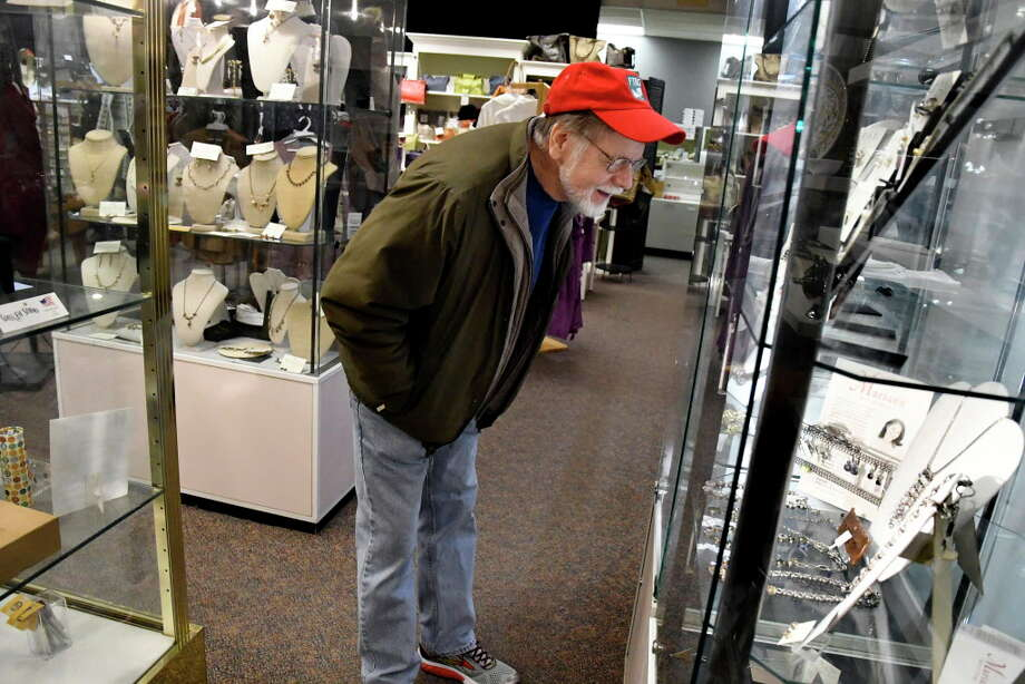 Albany shoppers will spend an average $768 per person this holiday season, according to WalletHub. Above, Bill Westwood of Albany peruses a jewelry case for a gift for his wife while last-minute Christmas shopping at Pearl Grant Richmans on Saturday, Dec. 24, 2016, at Stuyvesant Plaza in Guilderland, N.Y. (Cindy Schultz / Times Union) Photo: Cindy Schultz, Albany Times Union / Albany Times Union