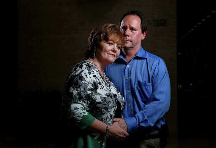 Lisa Smith poses for a portrait with her husband Howard Smith, Tuesday, Dec. 13, 2016, in Houston. Howard Smith was her caregiver while she underwent treatment for brain tumors. ( Jon Shapley / Houston Chronicle )