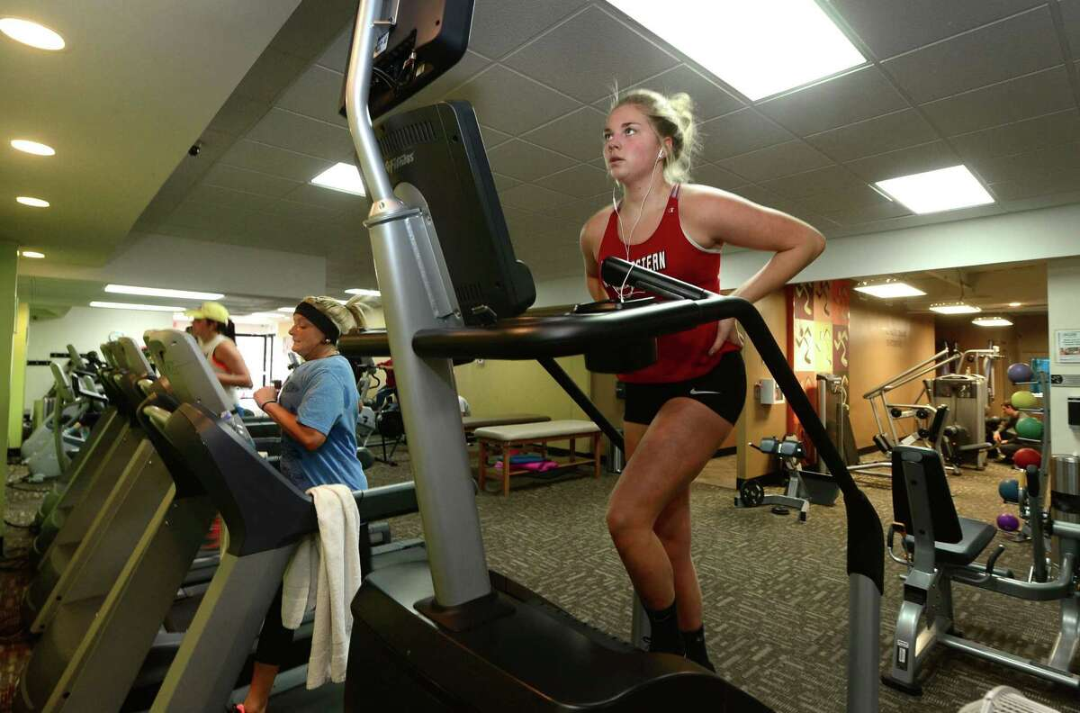 Victoria Markow works out Monday, December 26, 2016, at Anytime Fitnesss on Westport Ave. in Norwalk, Conn. The end of the year has manypeople making fitness based New Year?'s resolutions.