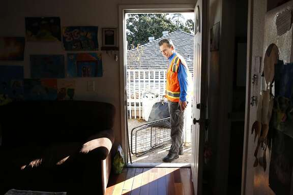 Noel Gallo speaks with a renter in her apartment who did not want to be identified about her poor living conditions in Gallo's district during a tour from Oakland City Council District 5 member Gallo around his district for the Chronicle Dec. 21, 2016 in Oakland, Calif.
