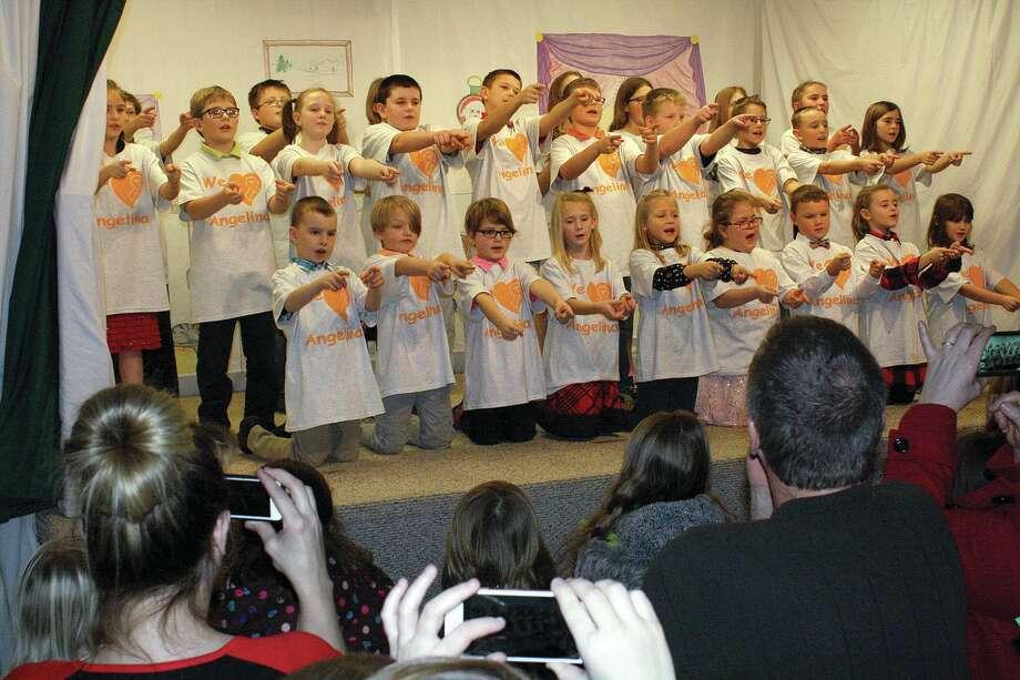 """Students at Eccles country school perform """"You've Got a Friend in Me,"""" a song they dedicated to a schoolmate who was recently diagnosed with leukemia. Photo: Rich Harp/For The Tribune"""