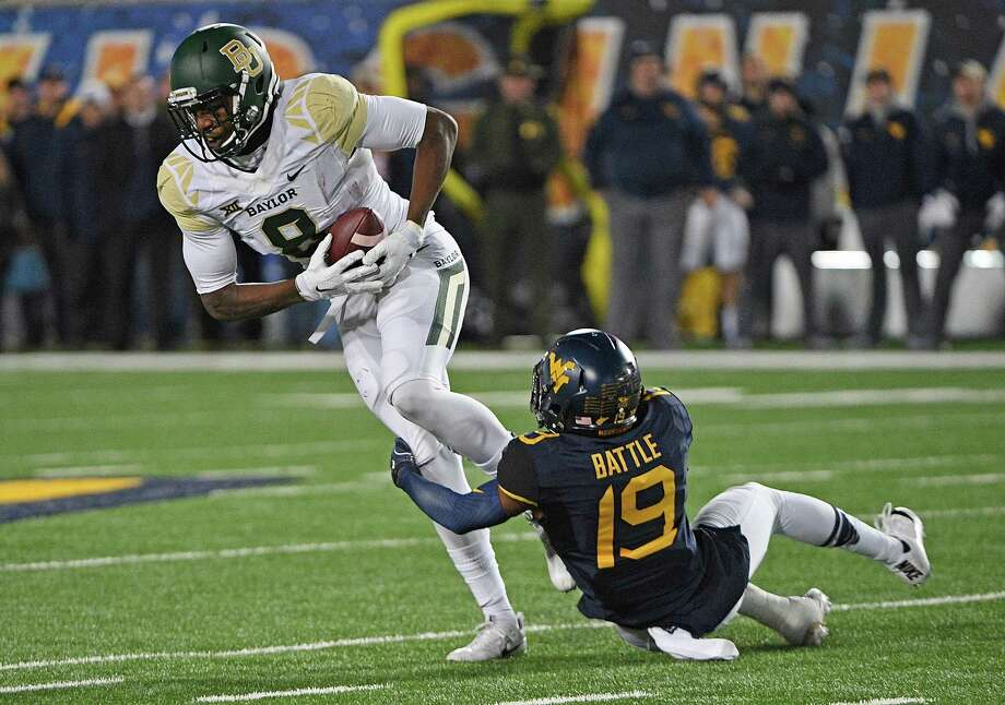MORGANTOWN, WV - DECEMBER 03:  Ishmael Zamora #8 of the Baylor Bears is wrapped up after a catch by Elijah Battle #19 of the West Virginia Mountaineers in the second half during the game at Mountaineer Field on December 3, 2016 in Morgantown, West Virginia. (Photo by Justin Berl/Getty Images) Photo: Justin Berl, Stringer / 2016 Getty Images