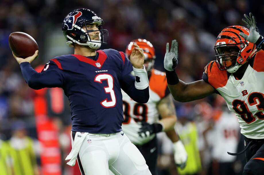 Houston Texans quarterback Tom Savage (3) looks to pass as the Cincinnati Bengals defenders close in during the first quarter of an NFL football game at NRG Stadium, Saturday,Dec. 24, 2016 in Houston.  ( Karen Warren / Houston Chronicle ) Photo: Karen Warren, Staff Photographer / 2016 Houston Chronicle