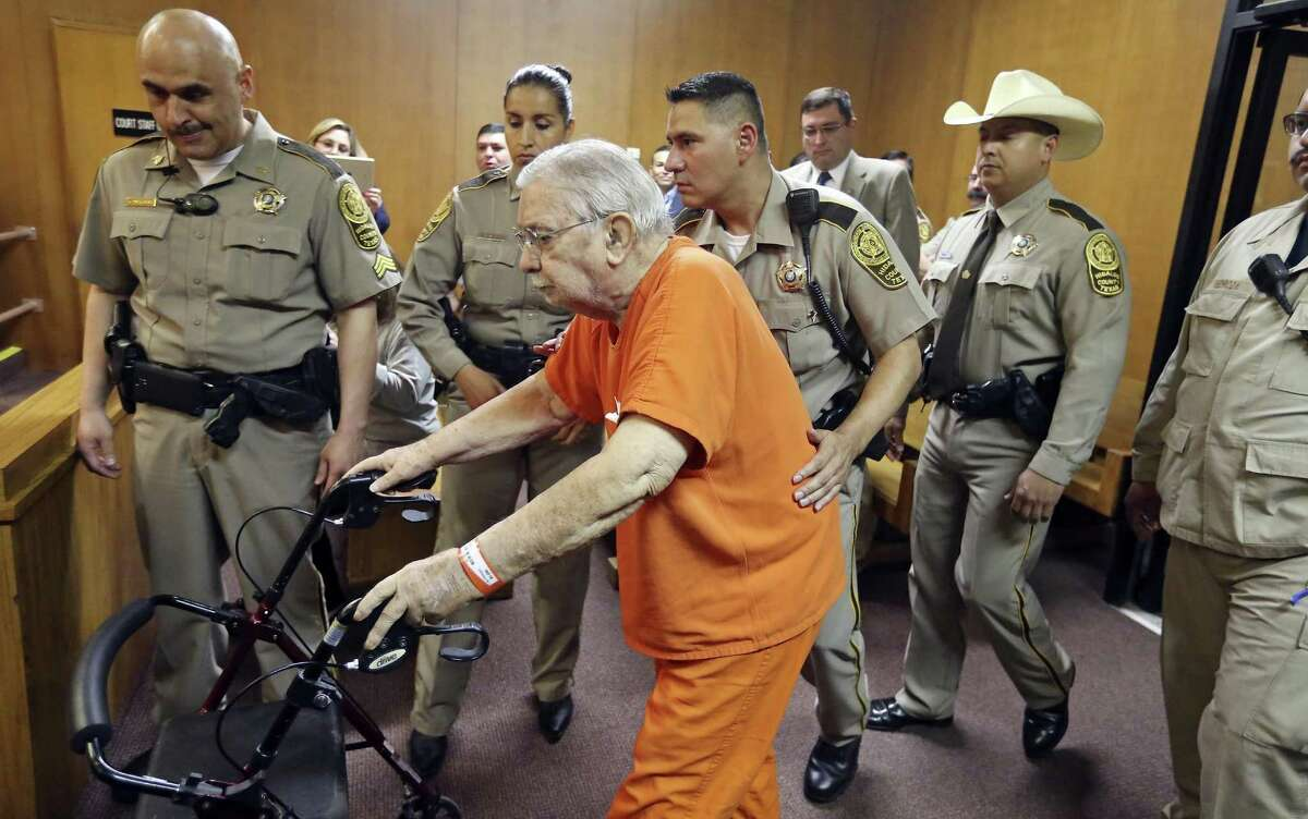 Former priest John Feit, 83, enters the 92nd State District Court for his arraignment Monday March 14, 2016 at the Hidalgo County Courthouse in Edinburg, TX. Feit is accused of killing Irene Garza, a 25-year-old elementary school teacher and former beauty queen, in 1960.