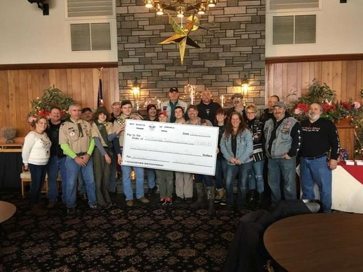Valatie Boy Scout Troop 2114 presented a check for $3,293.80 on Dec. 17 to East Coast Riders to support the Tim Beaucage Memorial Christmas Fund. (Submitted photo)